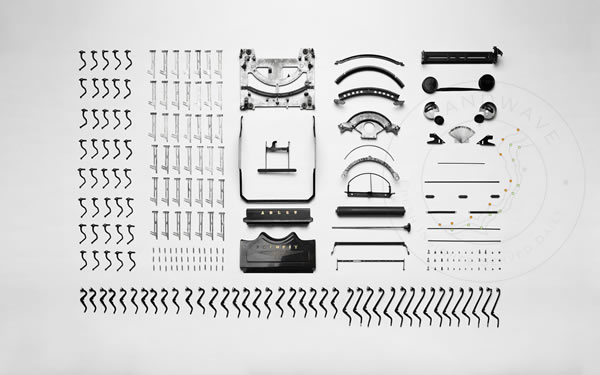 Image of disassembled typewriter parts neatly arranged
